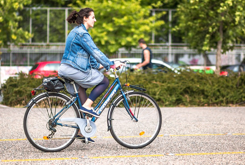 Young Happy Woman On Bike Ride In The City photo