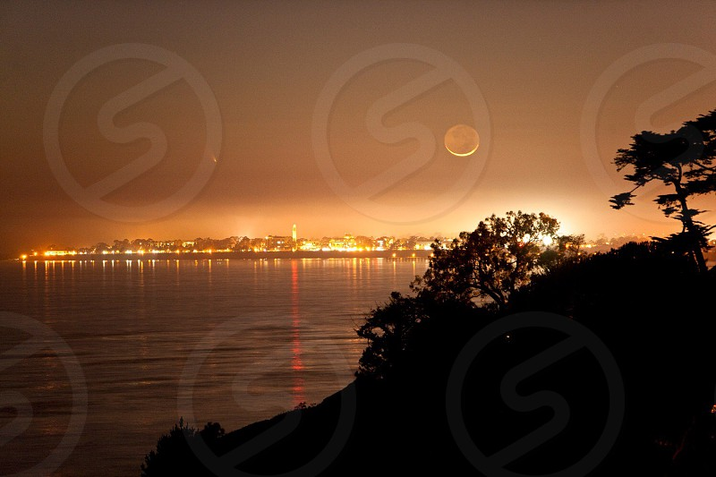city night light view near ocean photo