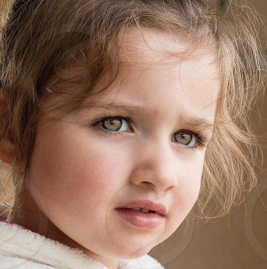 Pensive little girl.  She happened to be watching horses on the beach through our caravan window in Scotland. photo