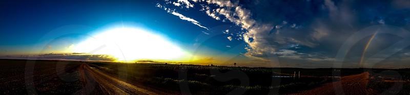 sung rising under blue sky photo