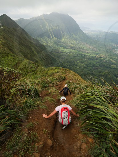 Hikers Scrolling down a mountain in Hawaii  photo