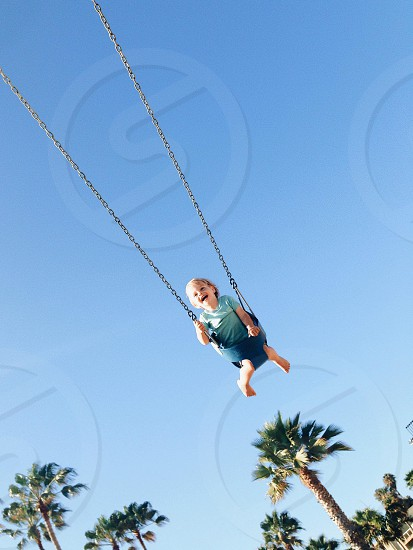child on swing photo