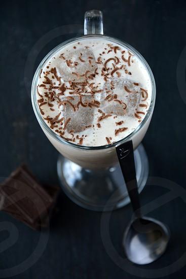 cold coffee drink chocolate milk ice dark background wooden background foodspouncocktail photo