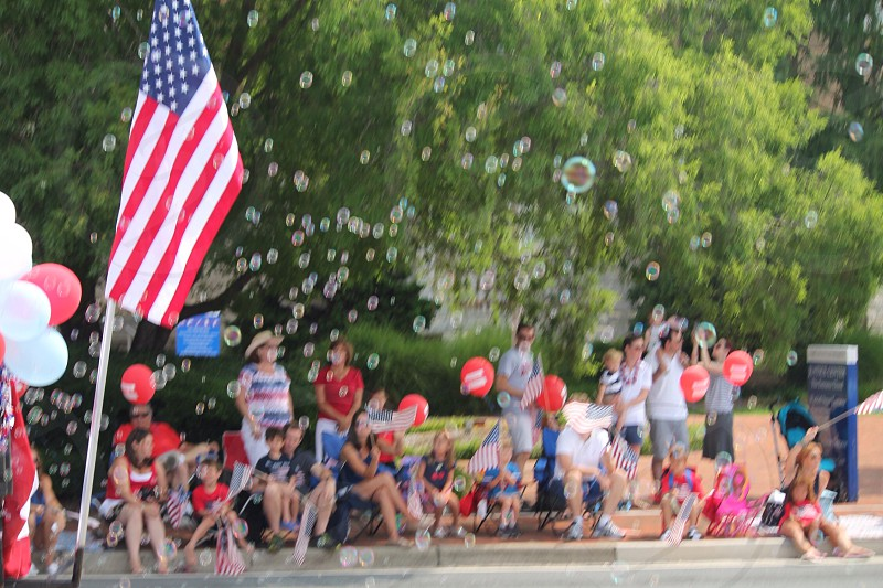 usa flag with people near the swimming pool photo