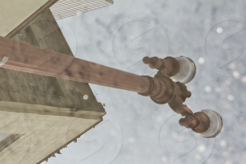 street light reflection in a water puddle photo