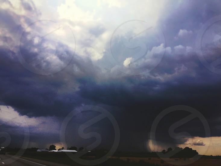 tornado on land during daytime photo