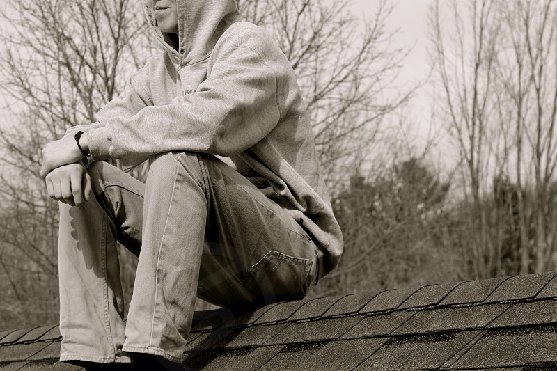 man on house roof portrait photography photo