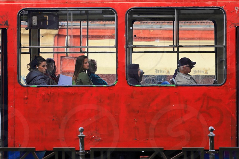 Passengers in an old red tram in Belgrade Serbia photo