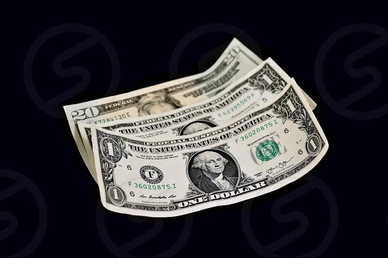 American dollar. Paper banknotes on a black background. US paper bills. American banknote images photo