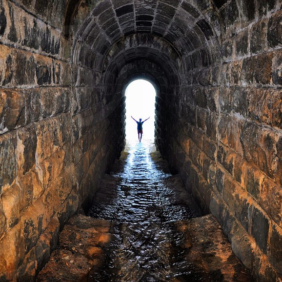 person at the end of the tunnel photo