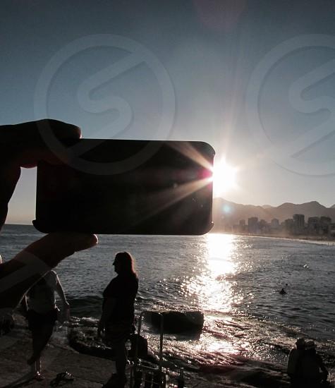 human talking a selfie during sunrise photo