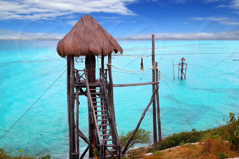 Caribbean zip line tyrolean turquoise sea  in  Mexico photo