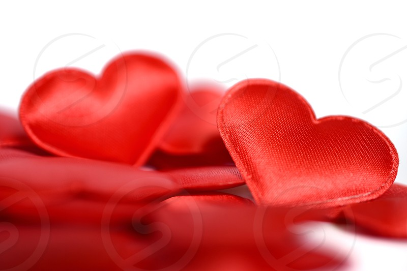 red fabric hearts accent photo