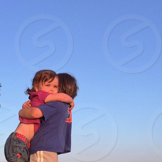 boy and girl hugging photo