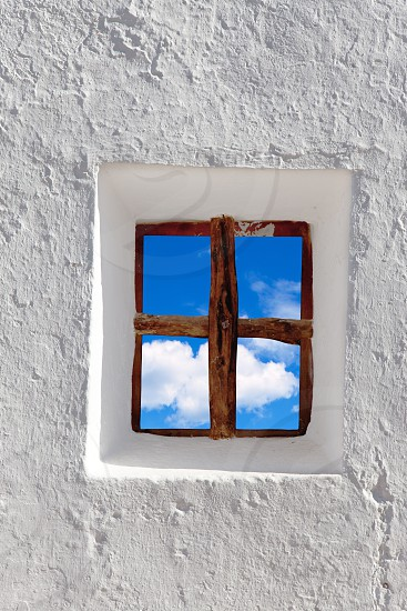 Balearic islands blue sky view through whitewashed house window photo