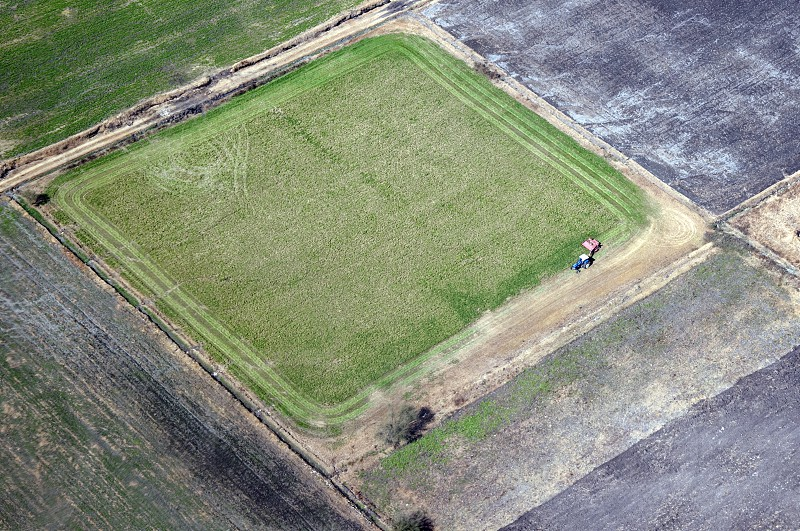 aerial view of a field agriculture from above tractor working harvest photo