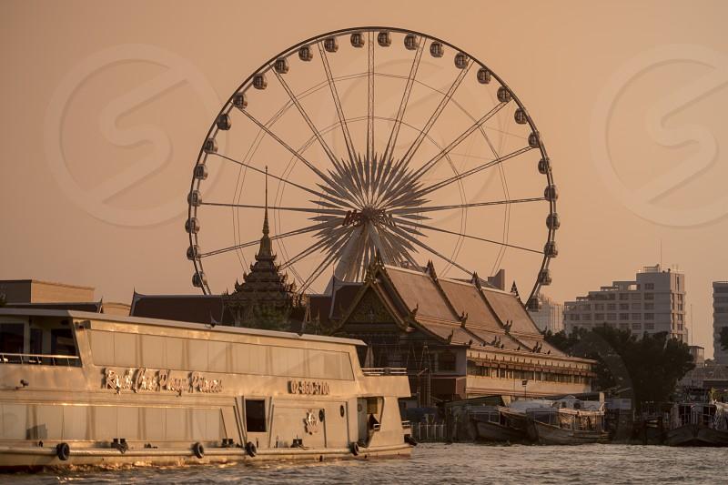 the Ferris Wheel of the Asiatique Riverfront Nightmarket in the city of Bangkok in Thailand.  Thailand Bangkok November 2017 photo