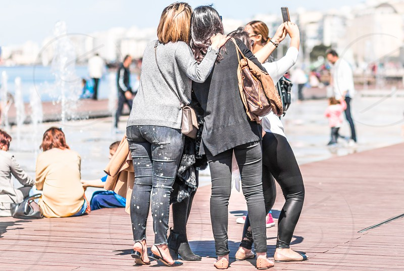 Group Of Friends Taking Selfie With Mobile Phone photo