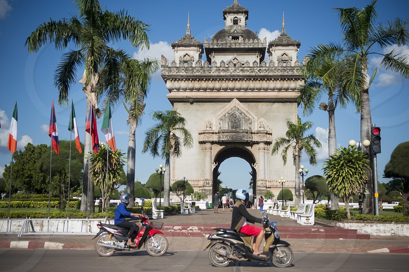 the patuxai arch in the city of vientiane in Laos in the southeastasia. photo
