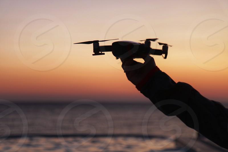 Drone action fly flying hand leisure fun sunrise sea summer closeup photo
