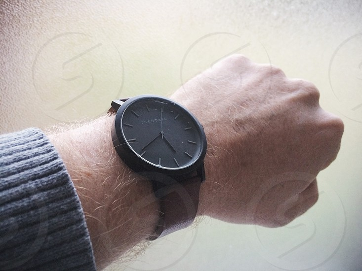 Man looking at a watch. photo