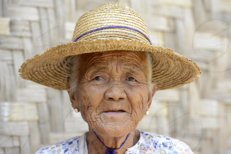 a old farmer women in the town of Nyaungshwe at the Inle Lake in the Shan State in the east of Myanmar in Southeastasia. photo