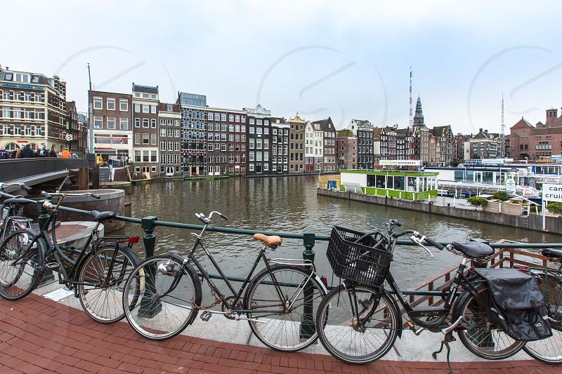 Amsterdam Nederland city bike river canal tourism travel  photo