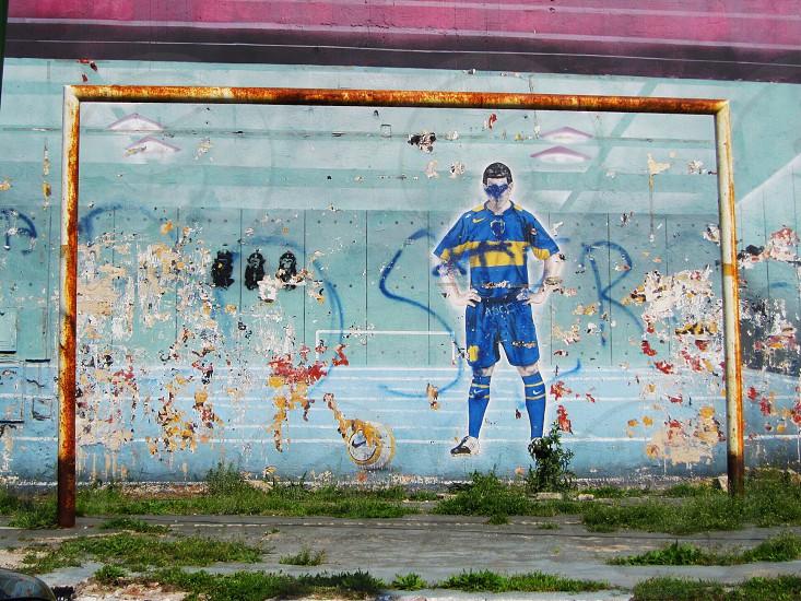 Street art representing a futbol player from Boca Juniors in Buenos Aires Argentina photo