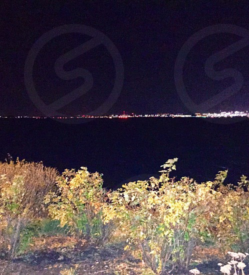 Night vision of Boston over the harbor  photo