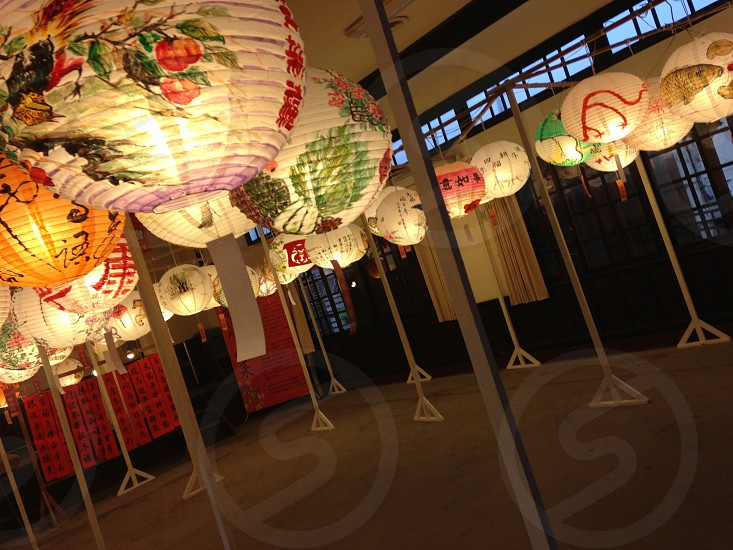 there are the symbol of Chinese new year day in Taiwan.  write the expectation of them in the white paper and hang it so they always think much of such old culture. nowadays i think it is lack of such passion so we must respect them and say thanks. photo