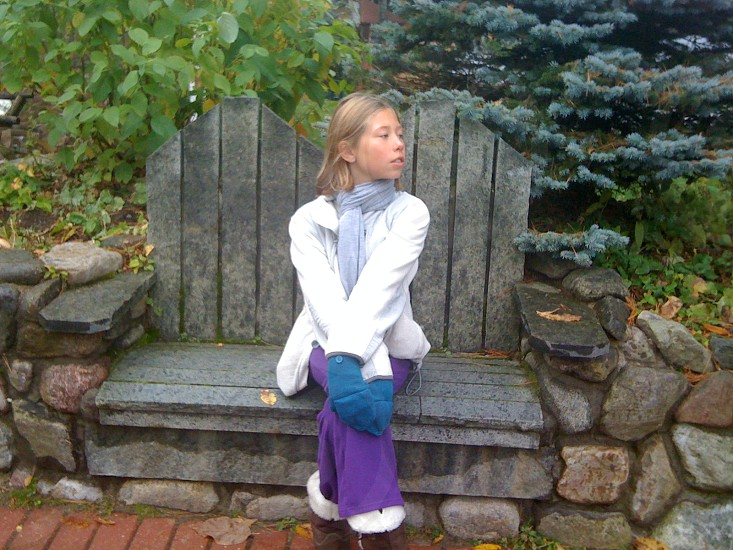 Daughter on a stone bench. photo