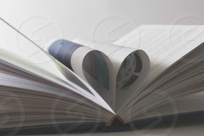 open book with the middle pages bent in photo