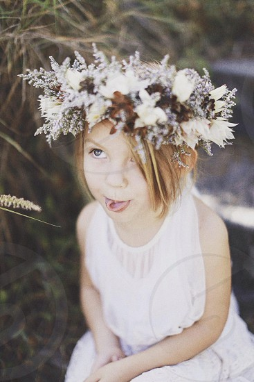 girl wearing white floral crown photo
