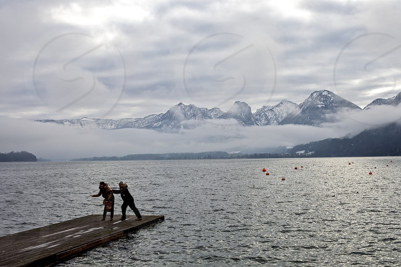 lake mountains people winter photo