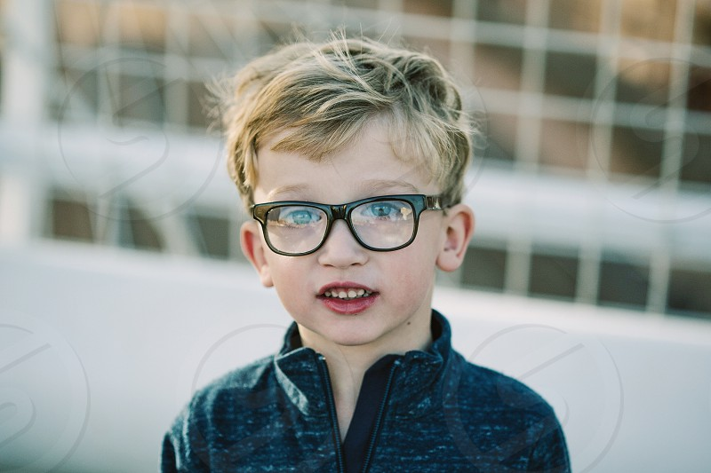 boy in black eye glasses with space dye shirt photo