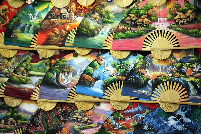 A hand fan in  shop in china town in the city of Singapore in Southeastasia. photo