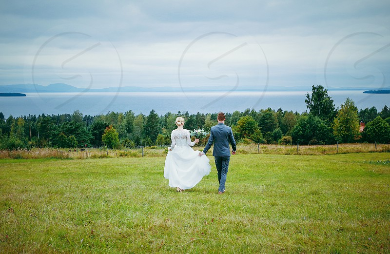 Wedding love married  marriage  green  nature grass lake sky couple summer romance  photo