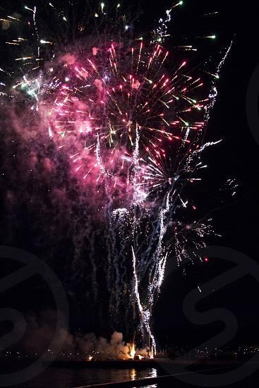 Fireworks display over lake photo