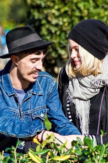 man in blue denim jacket near woman in black beanie photo
