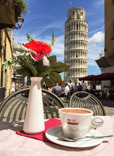 Outdoor day colour portrait vertical The Leaning Tower of Pisa Pisa Italy Europe European cafe lifestyle People watching relaxation holiday vacation hot chocolate cocoa travel tourist tourism wanderlust photo