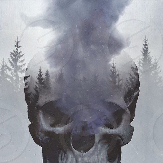 double exposure photo of skull with smoke coming out from it photo
