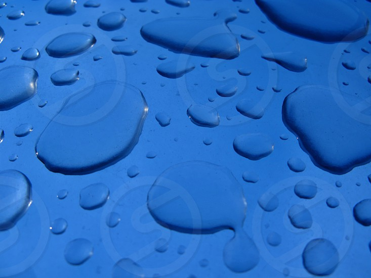 water droplets on blue surface photo