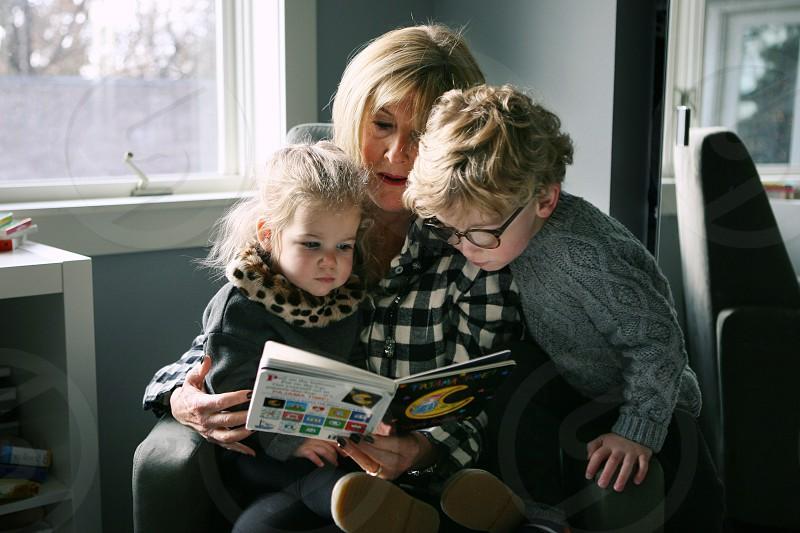give thanks family visiting grandma grandchildren thankful thanksgiving holidays vacation reading story time child children little girl little boy family love photo