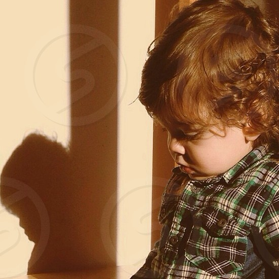 toddler wearing white black and green collared plaid shirt photo