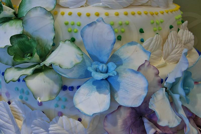 Sugar Fondant Flowers on a Wedding Cake photo