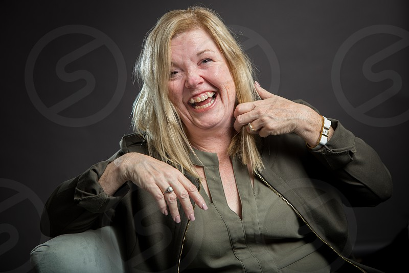A woman in a studio setting photo
