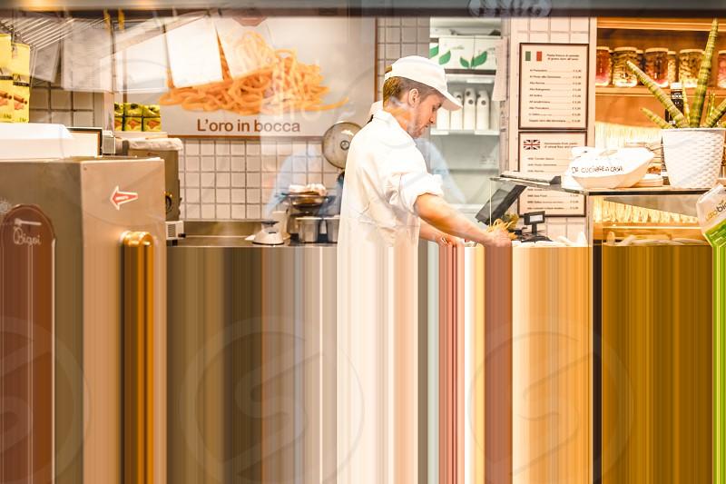 Chef Cooking Pasta In The Kitchen Restaurant photo