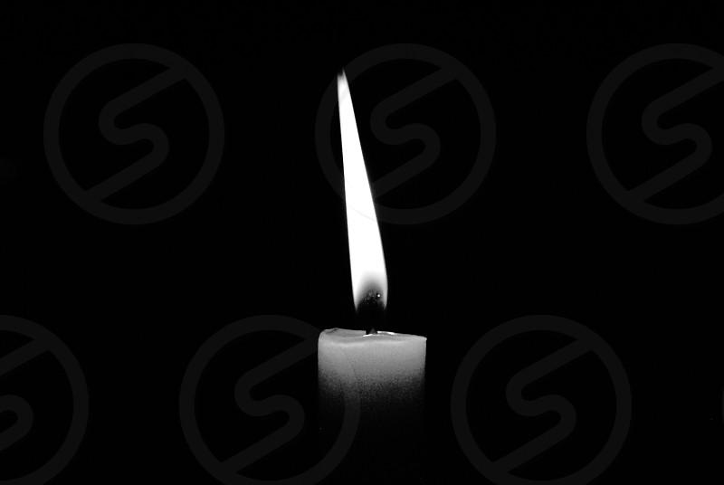 white lit candle stick photo
