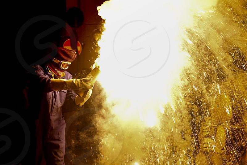 A person blows up a big firecracker and creates a gigantic blaze bright.. photo
