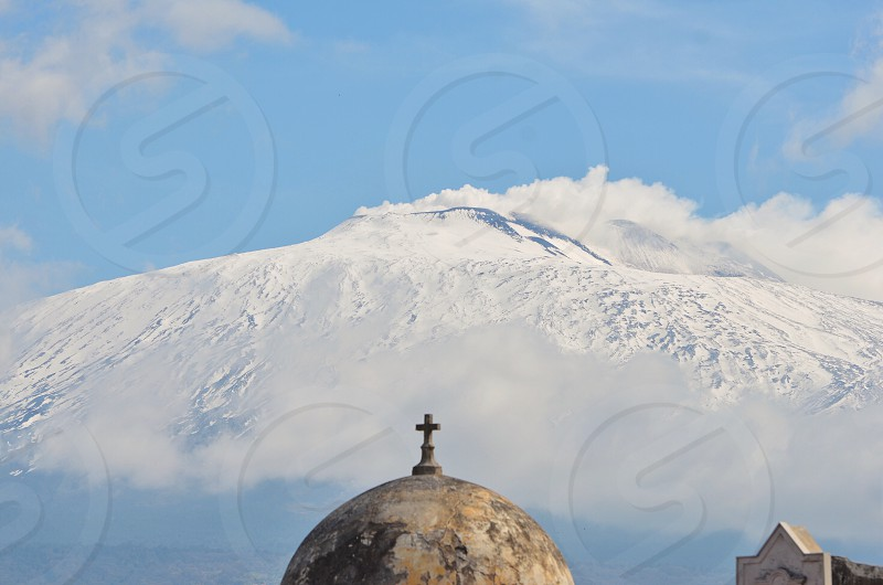 Rural church in Sicily with Etna volcano's view mountainsnowsnow coveredwinterroofcrossItaly photo